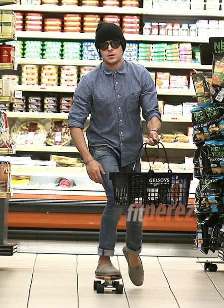 Zac Efron skates in grocery store