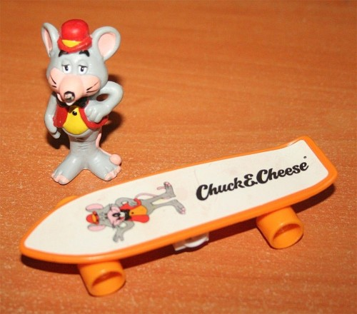 Chuck E Cheese on a skateboard